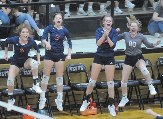 Members of the Jim Ned volleyball team celebrate a point against Clyde on Tuesday, Oct. 8, 2019, at Clyde High School.