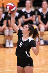 Wylie's Keetyn Davis (9) hits a shot against Wichita Falls Rider at Bulldog Gym on Tuesday, Oct. 8, 2019. The Lady Bulldogs won in five sets.