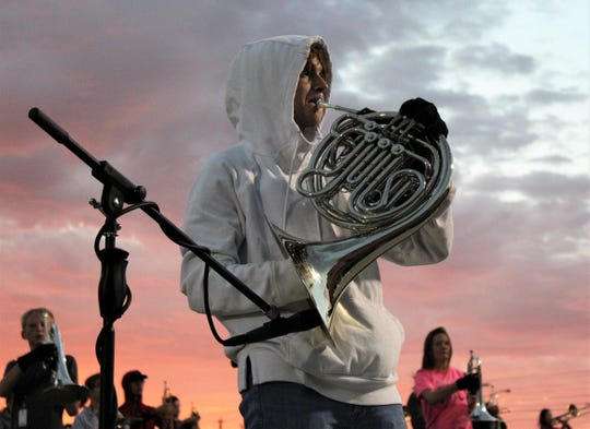 Junior Mark Huffines performs a French horn solo for Wylie High School's marching band show during daybreak rehearsal Wednesday at Bulldog Stadium. Wylie's annual Big Country Marching Festival is scheduled there Saturday.