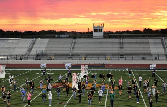 Bulldog Stadium lights are needed for morning band rehearsals before the start of classes at Wylie High School. The Pure Gold Band is host of Saturday's Big Country Marching Festival.