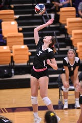 Wylie outside hitter Lilly Kate Doby (5) spikes the ball against Wichita Falls Rider at Bulldog Gym on Tuesday. Doby had 14 kills, three blocks and three aces as the Lady Bulldogs won in five sets.