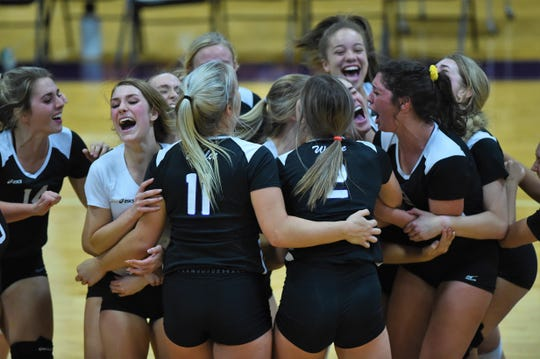 The Wylie volleyball team reacts to defeating Wichita Falls Rider in five sets at Bulldog Gym on Tuesday, Oct. 8, 2019. The victory gave the Lady Bulldogs sole possession of second place in District 4-5A heading into Friday's trip to Cooper.