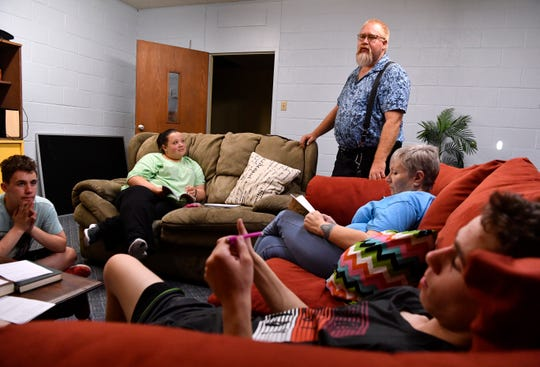 Gene McPeak drops in on a teen Bible study class Oct. 2 at Elmwood West United Methodist Church.