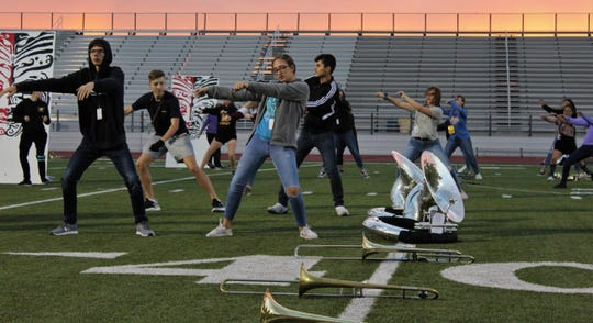 Halftime shows are not just about playing music, as Wylie High School musicians bust a few moves that are part of their UIL contest show. Front row, from left are senior Lucas Zwernemann and freshman Morgan Huck, and back row, from left, are freshmen Cole Tickner and Jerry Vela and sophomore Chrissy Prince.