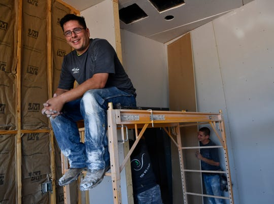 Jose Valenzuela at a job site Wednesday. He is the owner of Unique3 Solutions.
