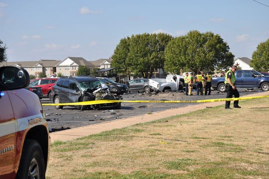 Debris was scattered through much of one parking row Wednesday at Abilene Christian School after a truck left the roadway and struck three vehicles.