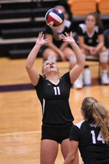 Wylie's Lexi Miller (11) sets the ball against Wichita Falls Rider at Bulldog Gym on Tuesday. Miller had 34 assists, 16 digs, two blocks and two aces in the Lady Bulldogs' five-set win.