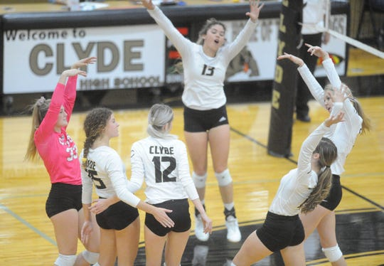 Members of the Clyde volleyball team celebrate a point against Jim Ned on Tuesday, Oct. 8, 2019, at Clyde High School.