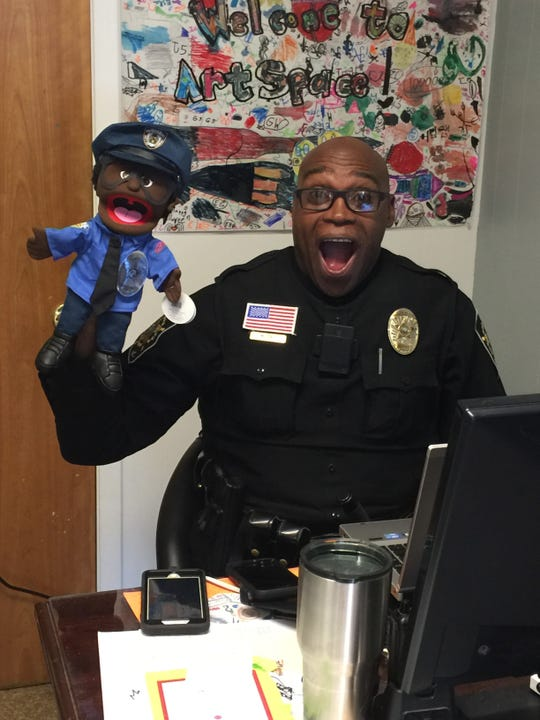 SRO Deputy Mickey Ray goofs off at ArtSpace Charter School, where he was assigned before he retired this summer.