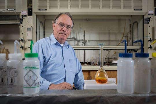 M. Stanley Whittingham, Distinguished Professor of Chemistry and Materials Science and Director of the Institute for Materials Research, pictured in one of his Science II laboratories, Tuesday, August 12, 2014.