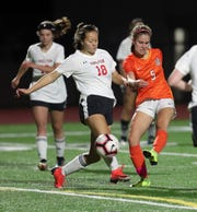 Central Kitsap's Marielle Arnold (5) and Shelton's Brooklyn McMillin (18) battle for control of the ball at Cougar Field in Silverdale on Tuesday, Oct. 8, 2019.
