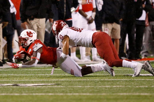Washington State linebacker Ron Stone Jr. (10) tackles Utah running back Devin Brumfield, left, in the first half of an NCAA college football game Saturday, Sept. 28, 2019, in Salt Lake City.