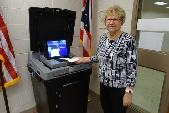 Ruth Leuthold, director of the Crawford County Board of Elections, demonstrates how ballots are cast using the county's new voting equipment on Wednesday in the board's office. Early voting began on Tuesday.