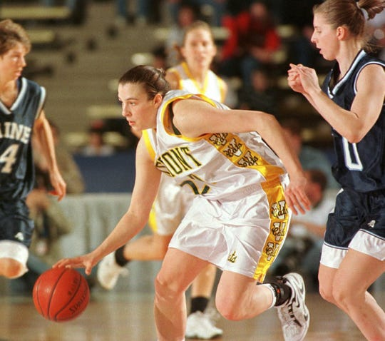 Vermont's Karalyn Church (20) breaks the full-court press, driving between Maine's Cindy Blodgett, left, and Klara Danes, right during the first half of the America East championship game in Orono, Maine, Saturday, March 7, 1998