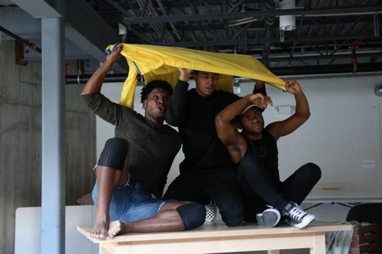 "The cast of the JAG Productions play ""Esai's Table"" - from left to right: Cornelius Davidson, Dimitri Carter and Marcus Gladney Jr. - rehearses for performances that will be staged in White River Junction from Oct. 10-27."