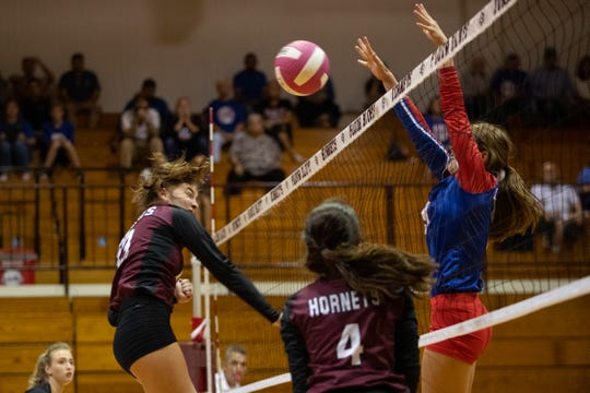 Gregory-Portland's Camryn Jones, right, has 338 kills and leads the Ladycats with 104 total blocks this season.