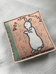Pat the Bunny needlepoint pillow by Clara Sharp.