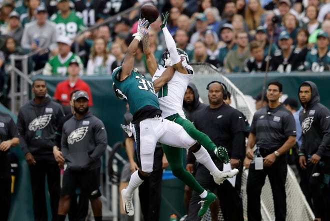 Eagles cornerback Craig James, left, defends a pass intended for Jets receiver Robby Anderson during a 31-6 win last Sunday.