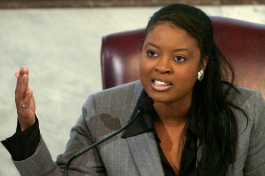 Then Cincinnati City Council member Alicia Reece speaks during a debate at City Hall in 2004.
