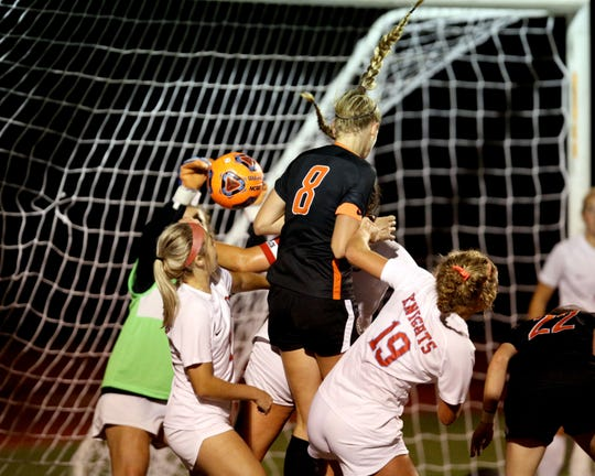 Anderson defender Karley Steiner heads the ball in for a goal in the girls soccer match between Kings and Anderson Oct. 8, 2019.