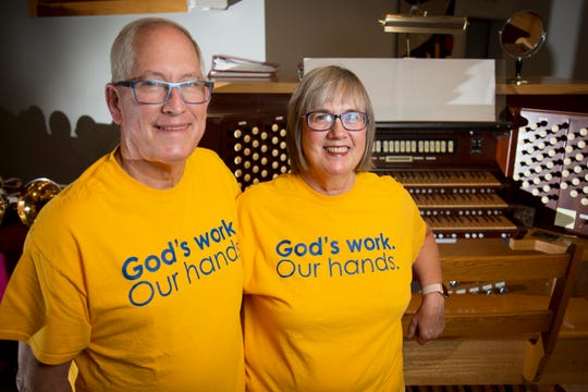 Bill and Kathy Shuman, of Oakley, pose in the sanctuary at Good Shepherd Lutheran Church in Kenwood, Ohio, on Tuesday, Oct. 8, 2019. The Shuman family received a $500 which they donated to support the music program at Taft Elementary School.