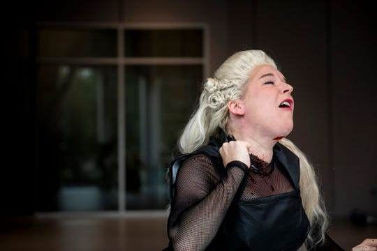 "Miranda McGee acts out a scene from ""Titus Andronicus""  to demonstrate how fake blood will be used in the upcoming show at the Cincinnati Shakespeare Company in Over-the-Rhine Monday, October 7, 2019."