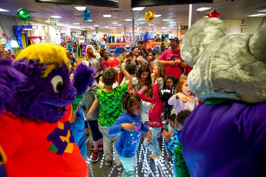 Kids jump around on the dance floor at the start of the inaugural dance party at the grand re-opening after it's redesign of the Chuck E. Cheese on Wilma Rudolph in Clarksville, Tenn., on Tuesday, Oct. 8, 2019.