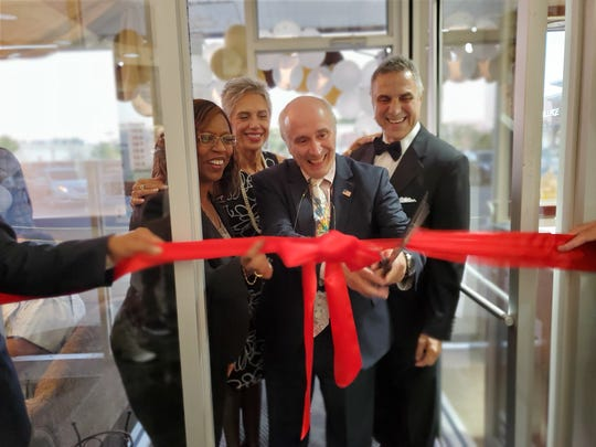 On Friday, Oct. 4, Venus Jewelers in the Somerset section of Franklin Township, hosted a ribbon cutting ceremony to commemorate its 40th anniversary.(Left to right)Councilwoman Kimberly Francois, Dora Fount, Mayor Phil Kramer andDr. Peter Stavrianidis.