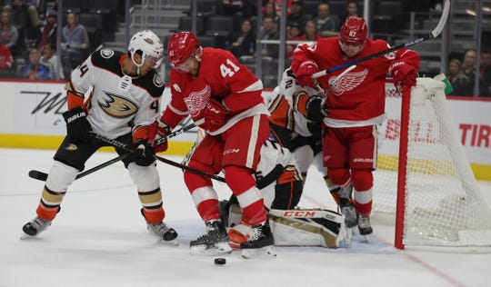 Detroit Red Wings center Luke Glendening (41) goes for the puck in front of the net against Anaheim Ducks defenseman Michael Del Zotto (44) during first period action Tuesday, October 8, 2019 at Little Caesars Arena in Detroit.