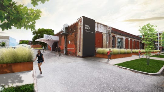 View shows planned new entrance to MOCAD, including an entrance canopy and site strategies along Garfield St.