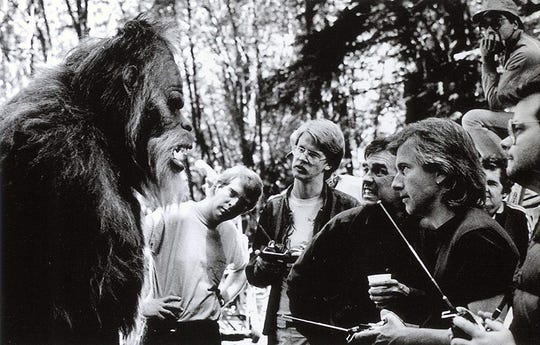 "William Dear, fourth from left, on location with cast and crew members during shooting in Seattle of 1987's ""Harry and the Hendersons."""