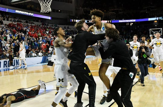 "Former Michigan guard Jordan Poole,  right, says he ""for sure"" would have been using his name for endorsements after his buzzer beater in 2018 beat Houston in the NCAA Tournament."