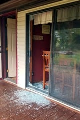 The broken glass from a sliding door at a home in Sullivan Township, Ohio.