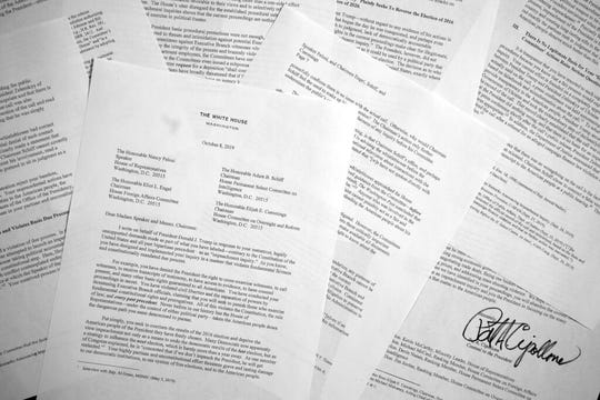 """A letter from White House counsel Pat Cipollone is photographed in Washington, on Tuesday, Oct. 8, 2019. The White House declared it will not cooperate with what it termed the """"illegitimate"""" impeachment probe by House Democrats, sharpening the constitutional clash between President Donald Trump and Congress."""