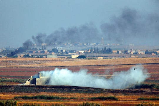 In this photo taken from the Turkish side of the border between Turkey and Syria, in Akcakale, Sanliurfa province, southeastern Turkey, smoke billows from targets inside Syria during bombardment by Turkish forces Wednesday, Oct. 9, 2019.