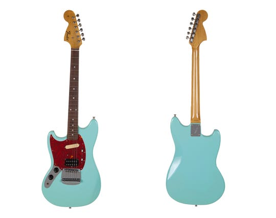 The front and back of a turquoise-bodied left-handed Fender guitar built in 1993 and used by Nirvana frontman Kurt Cobain during the band's In Utero tour.