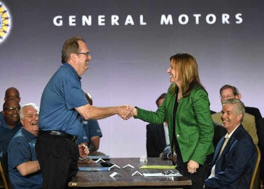 United Auto Workers President Gary Jones shakes hands with General Motors CO. CEO Mary Barra to kick off contract talks that culminated in a weeks-long national strike against the automaker. -- Max Ortiz, The Detroit News