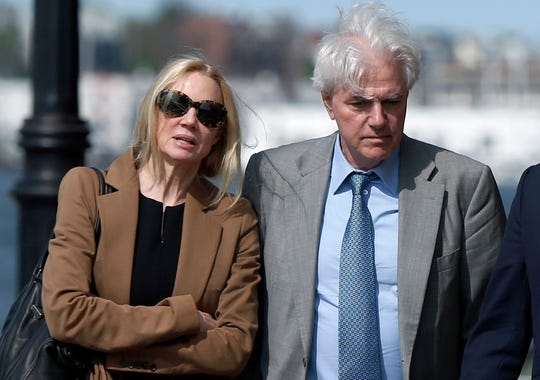 FILE - In this May 22, 2019 file photo, Marcia, left, and Gregory Abbott leave federal court after they pleaded guilty to charges in a nationwide college admissions bribery scandal. They are scheduled to be sentenced on Tuesday, Oct. 8.