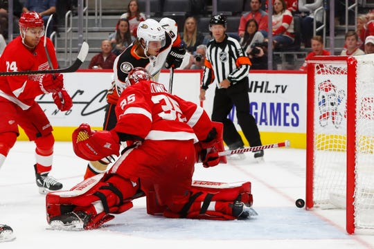 Ducks right wing Rickard Rakell scores on Red Wings goaltender Jimmy Howard in the third period.