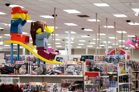 A display shows two large Lego toys on a slide near the toy section at a Target store in Bridgewater, N.J. The parent company of Toys R Us is teaming up with Target to relaunch Toysrus.com.