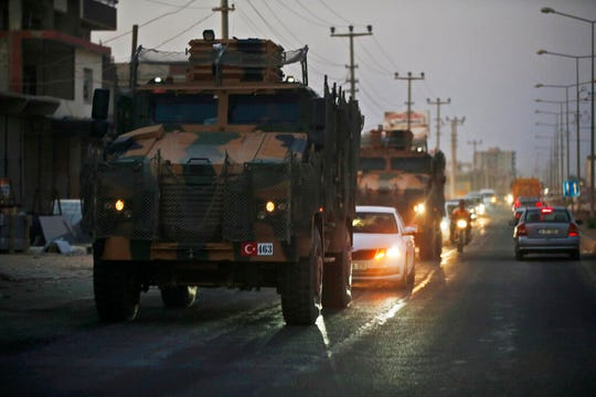 Shortly after the Turkish operation inside Syria had started, a convoy of Turkish forces vehicles is driven through the town of Akcakale, Sanliurfa province, southeastern Turkey, at the border between Turkey and Syria, Wednesday, Oct. 9, 2019.