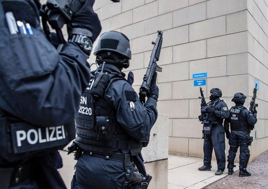 Police officers secure a synagogue in Dresden, Germany, Wednesday, Oct. 9, 2019.