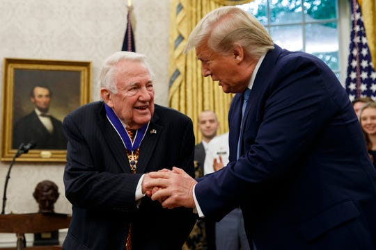 President Donald Trump shakes hands with former Attorney General Edwin Meese after presenting him the Presidential Medal of Freedom, in the Oval Office of the White House, Tuesday, Oct. 8, 2019, in Washington.