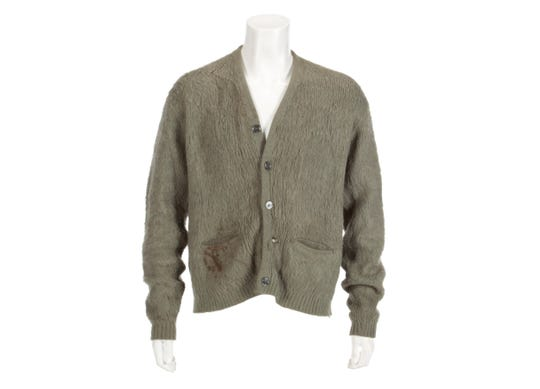 "An olive green cardigan sweater worn by Nirvana frontman Kurt Cobain during Nirvana's MTV's ""Unplugged"" performance."