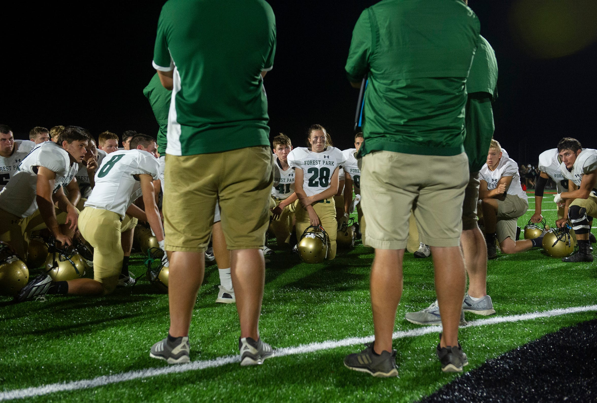 After a 24-11 defeat against the North Posey Vikings, the first loss of the season, the Forest Park Rangers take a knee and listen to their head coach Ross Fuhs at North Posey High School in Poseyville, Ind.