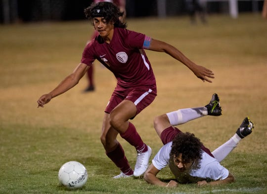 Henderson County's Hugo Gonzalez (6) wins the battle for the ball against Webster County's Roberto Lara (4) in the Sixth District Final at Union County High School Tuesday night.