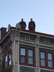 Batman and Robin keep a watchful eye over the Fall Festival grounds on Franklin Street in Evansville, Ind., Oct. 7, 1019.