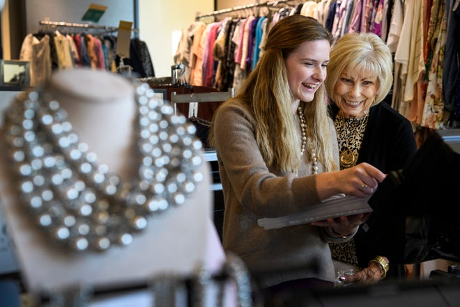 Molly Jillson, left, and her coworker Freda Sallee, right, look over sales numbers for the day at Chico's, located in the Evansville Pavilion Shopping Center, Thursday evening, Oct. 3, 2019. She balances her time between her job, classes at the University of Southern Indiana and pilates workouts while also managing her multiple sclerosis. She is helping to start the Strike Out MS Fastpitch Softball Tournament, which will be held Sunday, Oct. 13 to raise money for the Tri-State MS Association.