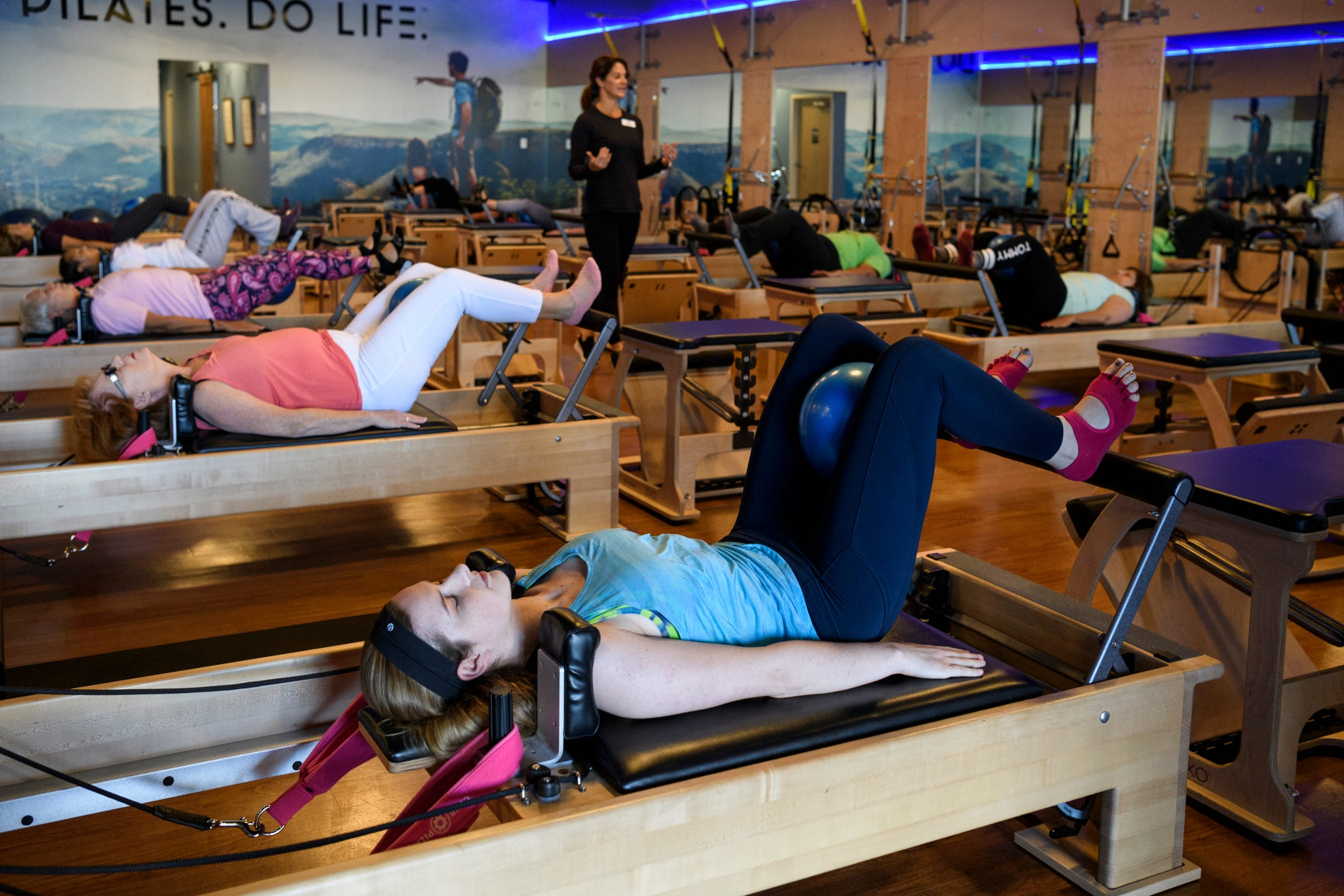 Molly Jillson, front, participates in a CP Reformer Flow class at Club Pilates in Evansville, Wednesday morning, Oct. 2, 2019. After being diagnosed with multiple sclerosis, she decided to do pilates to help with balance, control and flexibility.