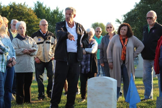 Local author Larry Michaels led a tour of Clyde's  McPherson Cemetery Tuesday.